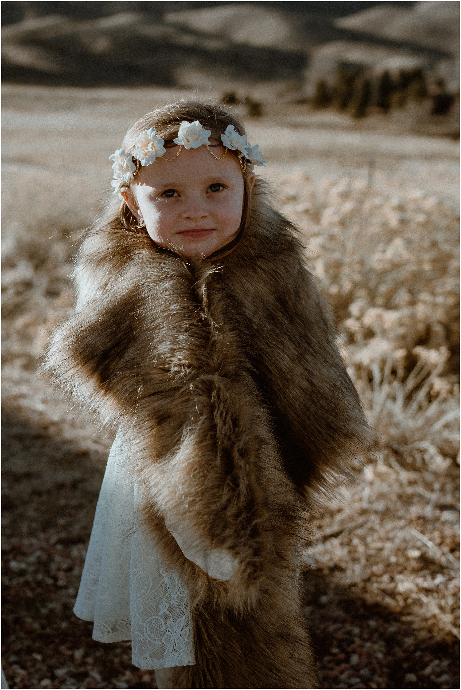 flower girl in fur shawl winter wedding